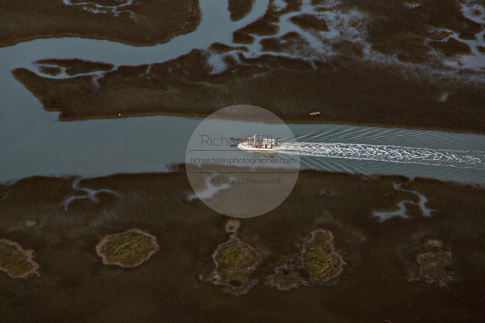 Aerial view of crab boat underway in the salt marsh estuary near Sullivans Island, South Carolina