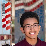 Elmer Milla, 16, poses for a photograph at Furr High School , October 2, 2015.