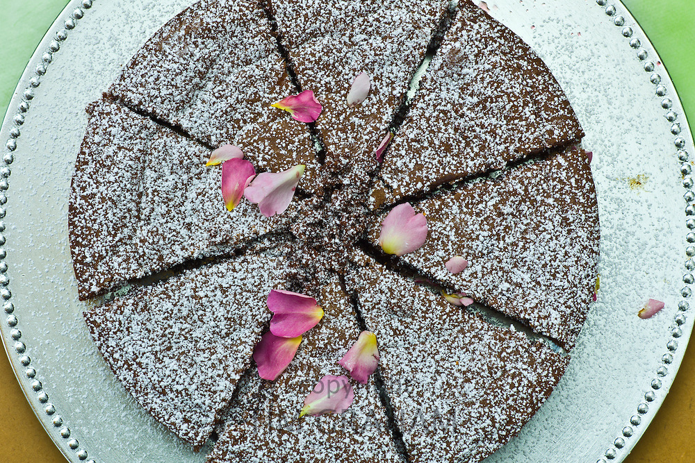 Home-baked chocolate cake with rose petals on sale at farmers' market, County Clare, West of Ireland