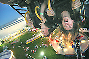 """(fired-up-side-down)  --  Screams, smiles and hair fly as Tabor Wyckoff (left), 13, and Austin Casey, 14, experience the looping ride """"Fire Ball"""" at this year's carnival for the Walla Walla Fair and Frontier Days.        Thursday, August 28, 2008        MZ Photo"""