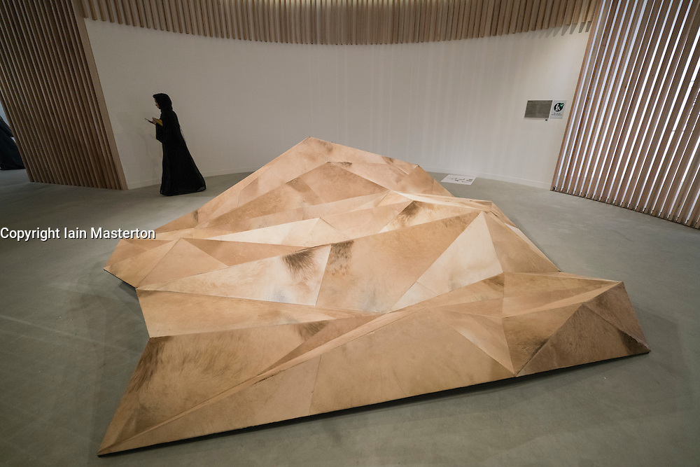 "Interactive art installation by Zeinab Al Hashemi "" Camouflage"" made from wood and camel hide on display at Abu Dhabi Art , modern art fair, held on Saadiyat Island , Abu Dhabi in November 2015 , United Arab Emirates"