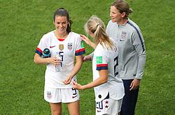 USA's Kelley O'Hara, Christen Press and head coach Jill Ellis after the final whistle