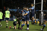 Gareth Anscombe of the Cardiff Blues (10) celebrates with teammates after he scores his teams 1st try.  Guinness Pro12 rugby match, Cardiff Blues v Leinster at the Cardiff Arms Park in Cardiff, South Wales on Saturday 1st October 2016.<br /> pic by Andrew Orchard, Andrew Orchard sports photography.