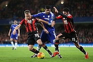 Diego Costa of Chelsea pulls down Matt Ritchie of Bournemouth by his neck. Barclays Premier league match, Chelsea v AFC Bournemouth at Stamford Bridge in London on Saturday 5th December 2015.<br /> pic by John Patrick Fletcher, Andrew Orchard sports photography.