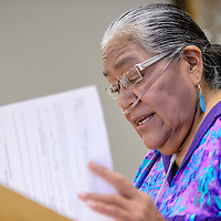 090914       Cable Hoover<br /> <br /> Flo Barton looks over the Red Rock Park bill during her presentation to Gallup city council at City Hall Tuesday. Barton, on behalf of the Gallup Inter-tribal Indian Ceremonial board, requested that the park fees be waived.