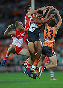 Israel Folau of the Giants and Andrejs Everitt of the Swans compete for the ball during the AFL Round 01 match between the GWS Giants and the Sydney Swans at ANZ Stadium, Sydney. (Photo: Craig Golding/AFL Media)