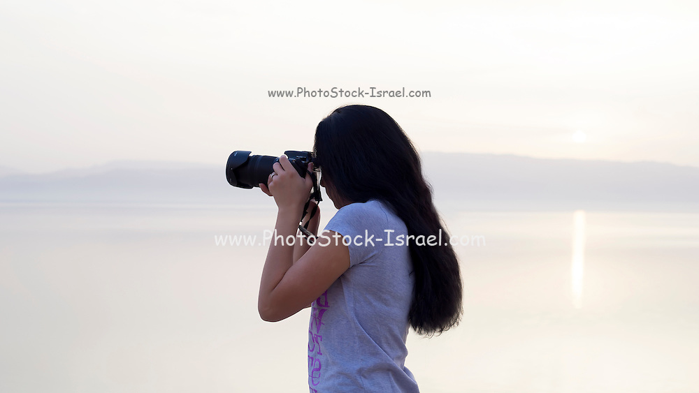 Young female photographer Model released