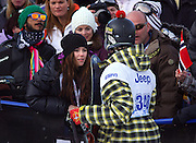 SHOT 1/26/08 3:38:40 PM - Norwegian snowboarder Andreas Wiig (right) talks with girlfriend Marion Raven (left), a Norwegian singer/songwriter, after one of his runs in the Snowboard Slopestyle finals event Saturday January 26, 2008 at Winter X Games Twelve in Aspen, Co. at Buttermilk Mountain. Wiig won the event with a score of 92.00, beating out U.S. riders Kevin Pearce (88.33) and Shaun White (83.33). It was the second year in a row Wiig has won gold in the event. The 12th annual winter action sports competition features athletes from across the globe competing for medals and prize money is skiing, snowboarding and snowmobile. Numerous events were broadcast live and seen in more than 120 countries. The event will remain in Aspen, Co. through 2010..(Photo by Marc Piscotty / WpN © 2008)