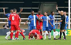 Peterborough United's Mark Little is sent-off for a challenge on Milton Keynes Dons' Dean Lewington - Photo mandatory by-line: Joe Dent/JMP - Tel: Mobile: 07966 386802 21/09/2013 - SPORT - FOOTBALL - London Road Stadium - Peterborough - Peterborough United V MK Dons - Sky Bet League 1