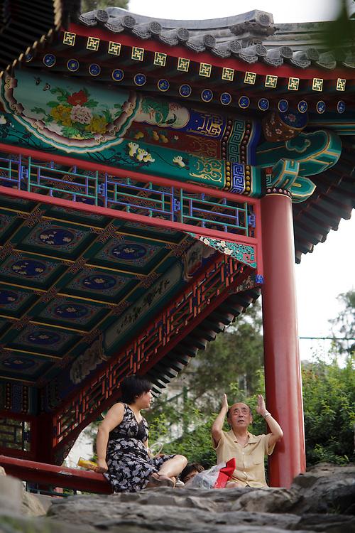 People enjoying a rest at Behau park in Beijing.