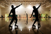 Students enjoy free roller skating and disco on Friday night at the Intramural Activities Center at the University of Washington campus in Seattle, Washington on October 13, 2006.
