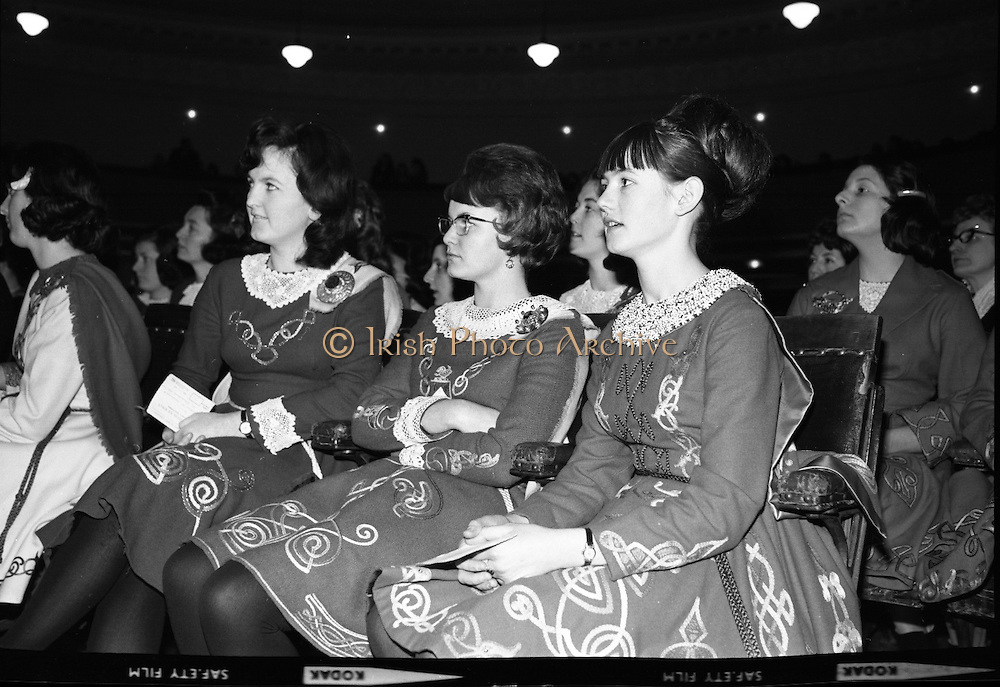Watching the other competitiors as they wait their turn in the Irish Dancing Championships at the Mansion House, Dublin, are (l-r) Ellan O'Connell, Dymphna O'Kelly and Alice Boyle, all from Dublin..21.02.1965