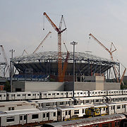 5,000 Ton Roof Superstructure now complete at Arthur Ashe Stadium.<br /> The United States Tennis Association announced Wednesday that the final piece of steel has been placed in the superstructure that will support the retractable roof over Arthur Ashe Stadium.  In all, 5,000 tons of steel were needed to complete the massive project.  The roof will be fully operational for the 2016 US Open.<br />  <br /> The retractable roof is the centerpiece of a complete re-imagining of the USTA Billie Jean King National Tennis Center.  The transformation of the site will include the roof over Arthur Ashe Stadium, a new 8,000-seat Grandstand Stadium, a new 14.000-seat Louis Armstrong Stadium, and the reconfiguration of the entire southern campus of the site.  Construction on the new Grandstand Stadium has begun, with 90,000 cubic yards of fill removed from the site.  The steel shell of the new stadium will begin to rise as foundation work is ongoing.  The Grandstand Stadium will open for the 2016 US Open.<br />  <br /> The USTA began the first phase of upgrades last year when the organization re-designed and rebuilt the West Stadium Courts and Practice Gallery.  Platform seating for 3,000 people was constructed so that, for the first time, fans could enjoy unobstructed views of US Open seeded players practicing. The structure also provided a prime viewing location for the three tournament courts to the west of Arthur Ashe Stadium.  Flushing, Queens, New York, USA. 11th June 2015. Photo Tim Clayton