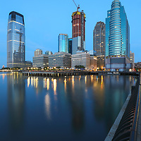 New Jersey and Jersey City skyline photography featuring iconic skyscrapers along the Hudson River on a quiet morning before sunrise. <br /> <br /> This Jersey City skyline photography image is available as museum quality photography prints, canvas prints, acrylic prints or metal prints. Prints may be framed and matted to the individual liking and decorating needs: <br /> <br /> https://juergen-roth.pixels.com/featured/jersey-city-juergen-roth.html<br />  <br /> Good light and happy photo making!<br /> <br /> Juergen<br /> Prints: http://www.rothgalleries.com<br /> Photo Blog: http://whereintheworldisjuergen.blogspot.com<br /> Twitter: @NatureFineArt<br /> Instagram: https://www.instagram.com/rothgalleries<br /> Facebook: https://www.facebook.com/naturefineart
