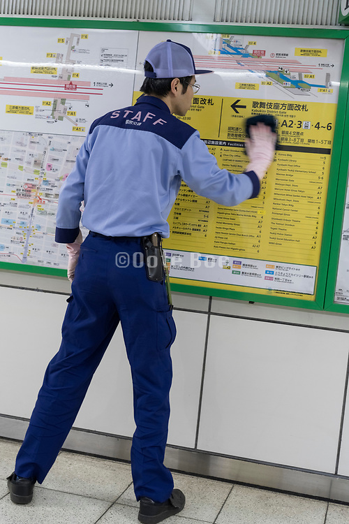 station staff worker cleaning Japan Tokyo