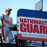 Driver Dale Earnhardt Jr. sits on the top of his trailer during the  56th Annual NASCAR Daytona 500 practice session at Daytona International Speedway on Wednesday, February 19, 2014 in Daytona Beach, Florida.  (AP Photo/Alex Menendez)