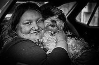 Marcelle with one of her nine dogs, all of them in the car. Burgundy, France.