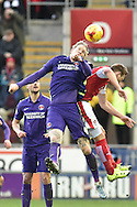 Simon Makienok of Charlton Athletic and Luciano Becchio of rotherham United go for the ball in the air  during the Sky Bet Championship match between Rotherham United and Charlton Athletic at the New York Stadium, Rotherham, England on 30 January 2016. Photo by Ian Lyall.