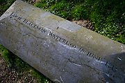 The tombstone of Captain John Lucie Blackman, an officer of the Coldstream Guards, killed by a French bullet in Hougoumont Farm, at the very end of the Battle of Waterloo, on 25th March 2017, at Waterloo, Belgium. The farm became an epicentre of fighting in the Battle as it was one of the first places where British and other allied forces faced Napoleons Army. 12,000 allied troops defending 14,000 French. The Battle of Waterloo was fought on 18 June 1815. A French army under Napoleon Bonaparte was defeated by two of the armies of the Seventh Coalition: an Anglo-led Allied army under the command of the Duke of Wellington, and a Prussian army under the command of Gebhard Leberecht von Blücher, resulting in 41,000 casualties.