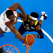 Anadolu Efes's Bryant Dunston (L) and Fenerbahce's Bobby Dixon during their Turkish Basketball Spor Toto Super League match Anadolu Efes between Fenerbahce at the Abdi ipekci arena in Istanbul, Turkey, Thursday 24, December 2015. Photo by Aykut AKICI/TURKPIX