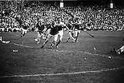 06/09/1970<br /> 09/06/1970<br /> 6 September 1970<br /> All-Ireland Senior Hurling Final: Cork v Wexford at Croke Park, Dublin. <br /> <br /> Wexford back, E. Colfer (right), tries to stop R. Cummins (Cork full forward) from shooting at the goal.