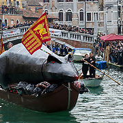 """VENICE, ITALY - FEBRUARY 16:  The """"Pantegana""""  (Big Rat) sails on the Canaregio Canal for the traditional regatta which officially opens the Carnival  on February 16, 2014 in Venice, Italy. The 2014 Carnival of Venice will run from February 15 to March 4 and includes a program of gala dinners, parades, dances, masked balls and music events.  (Photo by Marco Secchi/Getty Images)"""
