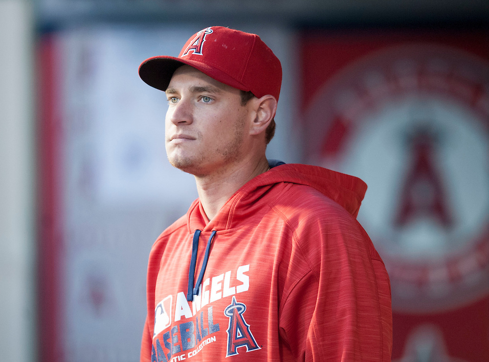 Garrett Richards watches from the dugout during the Angels game against the St. Louis Cardinals Tuesday at Angel Stadium.<br /> <br /> ///ADDITIONAL INFO:   <br /> <br /> angels.0511.kjs  ---  Photo by KEVIN SULLIVAN / Orange County Register  --  5/10/16<br /> <br /> The Los Angeles Angels take on the St. Louis Cardinals at Angel Stadium Tuesday.<br /> <br />  5/10/16