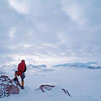 ANTARCTICA. Mountaineer Vern Tejas on Mount Vaughan in Queen Maud Mountains, part of the vast Trans-Antarctic Mountains. Cappellari and Amundsen Glaciers bkg.