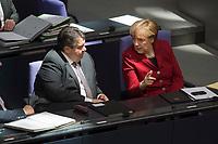 19 MAR 2015, BERLIN/GERMANY:<br /> Sigmar Gabriel (L), SPD, Bundeswirtschaftsminister, und Angela Merkel (R), CDU, Bundeskanzlerin, (Merkel sitzt in einem Sonnenstrahl, der aus der Kuppel reflektiert wird), im Gespräch, waehrend der Bundestagsdebatte nach der Abgabe einer Regierungserklaerung durch die Bundeskanzlerin<br /> zum Europaeischen Rat, Plenum, Deutscher Bundestag<br /> IMAGE: 20150319-01-057<br /> KEYWORDS: Gespräch