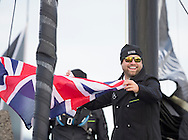 The Vendee Globe 2016. Les Sables d'Olonne. France<br /> British yachtsman Alex Thomson, skipper of the Hugo Boss IMOCA Open60 race yacht. Shown here traveling through the canal with spectators cheering. Prior to the start of the solo non stop around the world yacht race later today. <br /> Credit - Lloyd Images