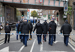© Licensed to London News Pictures. 17/10/2017. London, UK. A police search team gets to work at the crime scene. Police are investigating after a man in his 20's was stabbed to death and two others were injured in an incident on Monday night outside Parsons Green underground station a terrorist attack took place last month. Photo credit: Peter Macdiarmid/LNP