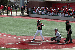 26 April 2014:  Daniel Dwyer bats in front of Matt Jones and umpire Bret Bruington during an NCAA Division 1 Missouri Valley Conference (MVC) Baseball game between the Southern Illinois Salukis and the Illinois State Redbirds in Duffy Bass Field, Normal IL