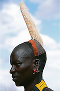 Hamar man with clay hairdo topped by an ostrich plume, in South Omo, Ehtiopia. The 40,000-strong, cattle-herding Hamar are among the largest of the 20 or so ethnic groups which inhabit this culturally diverse region in south-west Ethiopia.