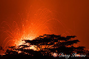 lava emanating from Kilauea Volcano, erupts at night from a fissure in the east rift zone, near a residence off Highway 132 between Pahoa and Kapoho in Puna District, Hawaii ( the Big Island ), Hawaiian Islands, U.S.A. ( Central Pacific Ocean ); wobbles in the light streaks are caused by the ground shaking and vibrating the camera tripod when violent explosions ejected lava bombs high into the sky
