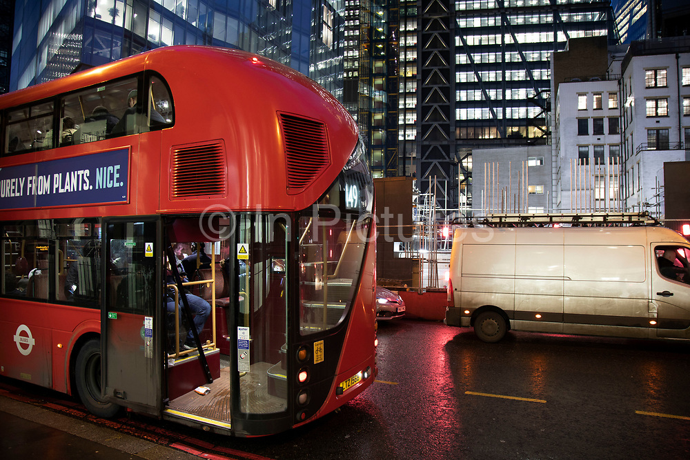 Modern Routemaster bus in the City of London on 26th November 2019 in London, England, United Kingdom. The New Routemaster, originally referred to as the New Bus for London, is a hybrid diesel electric double decker bus designed by Heatherwick Studio and manufactured by Wrightbus, it is notable for featuring a hop-on hop-off rear platform similar to the original Routemaster bus design but updated to meet requirements for modern buses to be fully accessible. They first entered service in February 2012.