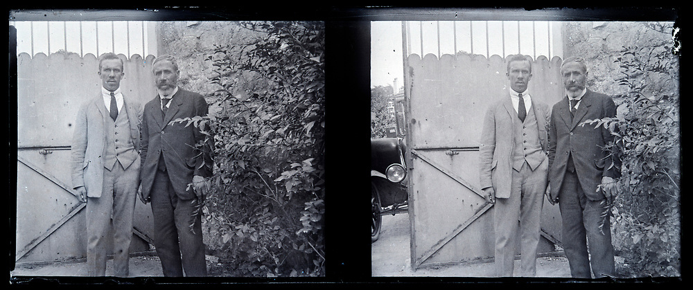 two adult man standing by the entrance gate France 1910s