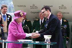 Trainer Aiden O'Brien (right) shakes hands with Queen Elizabeth II after winning the Hardwicke Stakes with horse Idaho
