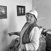 TIMISOARA, ROMANIA - APRIL 21:  A woman who lives in the outskirt of the city shows pictures of when she was young and her daughters on April 21, 2013 in Timisoara, Romania.  Romania has abandoned a target deadline of 2015 to switch to the single European currency and will now submit to the European Commission a programme on progress towards the adoption of the Euro, which for the first time will not have a target date. (Photo by Marco Secchi/Getty Images)