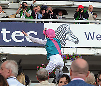 Flat Horse Racing - 2017 Investec Derby Festival - Ladies Day<br /> <br /> Frankie Dettori  on Enable jumps off his horse after winning the 16: 30 Investec Oaks, at Epsom Racecourse.<br /> <br /> COLORSPORT/ANDREW COWIE