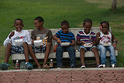 Kids having lunch<br /> Zoo<br /> Georgetown<br /> GUYANA<br /> South America