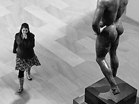 Young woman averting her eyes while passing a provocative Ancient Roman statue at The Metropolitan Museum of Art