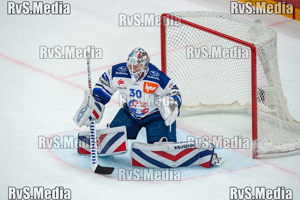 LAUSANNE, SWITZERLAND - OCTOBER 01: Goalie Lukas Flueler #30 of ZSC Lions in action during the Swiss National League game between Lausanne HC and ZSC Lions at Vaudoise Arena on October 1, 2021 in Lausanne, Switzerland. (Photo by Robert Hradil/RvS.Media)