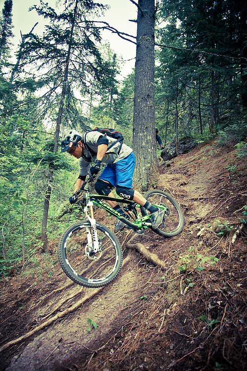 Professional mountain biker Andrew Shandro rides the Downtown trail in Copper Harbor Michigan.