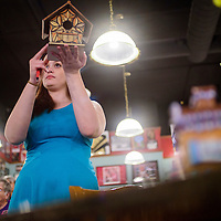 050315       Cable Hoover<br /> <br /> Lena Stanley displays one birdhouse for the audience to see during the annual Relay for Life Birdhouse Auction Sunday at Sammy C's in Gallup. The event, now in its eighth year, typically raises about $6000 to support the American Cancer Society.