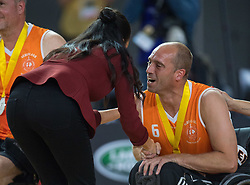 The Duchess of Sussex is kissed by Dutch athlete Jelle van der Steen during the medal presentations at the Invictus Games 2018 wheelchair basketball final in Sydney.