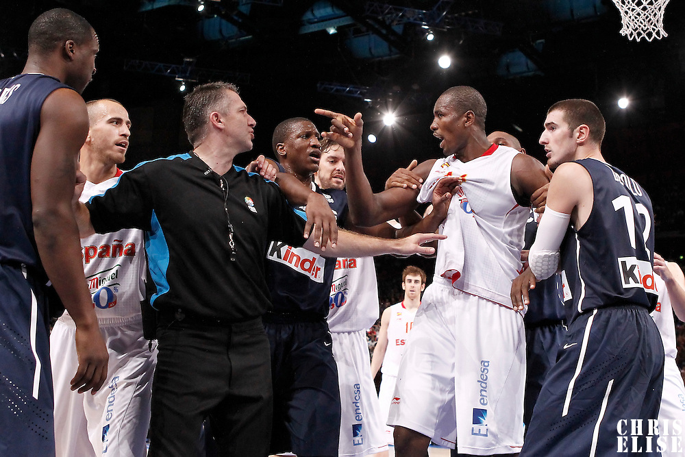 15 July 2012: Serge Ibaka of Team Spain argues with Florent Pietrus of Team France during a pre-Olympic exhibition game won 75-70 by Spain over France, at the Palais Omnisports de Paris Bercy, in Paris, France.