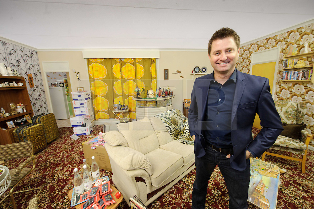 © Licensed to London News Pictures. 15/03/2013 London, UK.  George Clarke with  replica of Dell Boy's famous Peckham flat at the Ideal Home Show 2013. The celebrity designer has re-fitted the Trotters Only Fools and Horses residence and  given it a modern makeover..Photo credit : Simon Jacobs/LNP