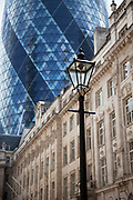 The old and the new. The Gherkin in the City of London and some older buildings.