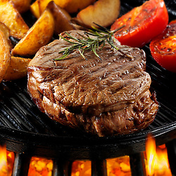 Beef fillet steaks & chips being pan fried on a bbq. Meat food photos, pictures & images.