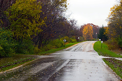 30 October 2009:  Water flows across the access road into Moraine View State Park near Leroy Illinois as the rain continues to fall.